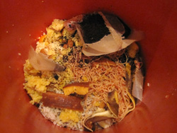 Place food scraps in the bucket